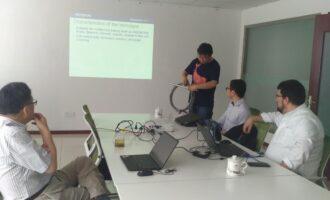 江苏中特与奥林巴斯公司专家共同攻关技术难题